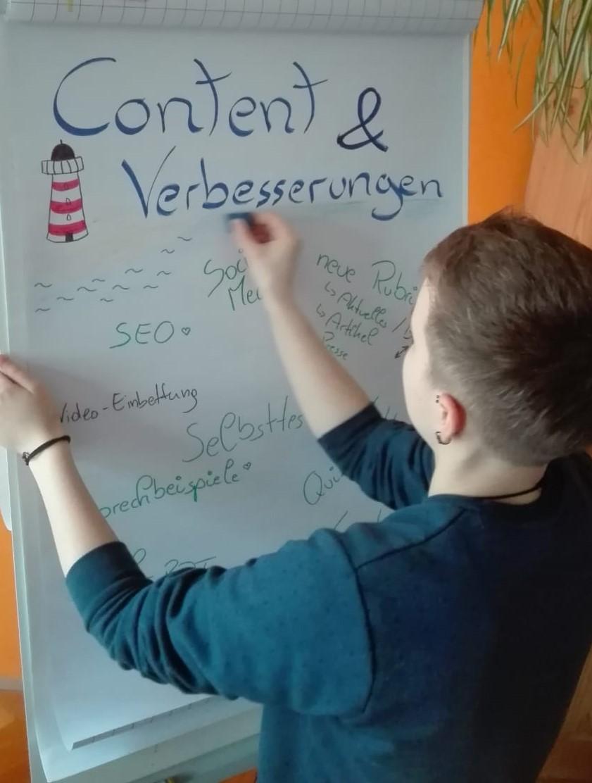 Das Bild zeigt ein Flip-Chart mit Brainstorming zum Thema